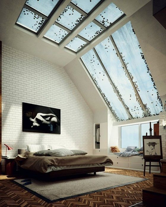 Sleeping space defined by placing it in a steep and large roof window, which adds to the room lighting.