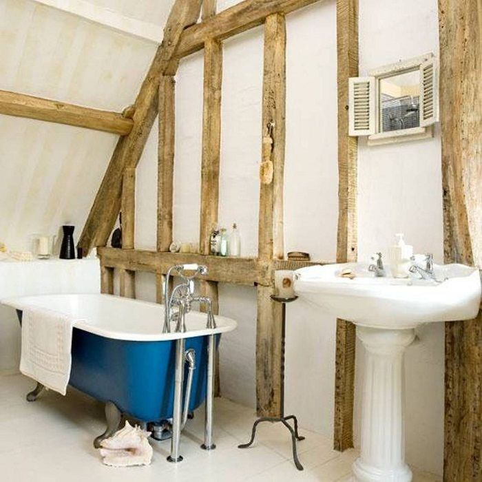 Beautiful and simple bathroom interior, which is located under the attic.