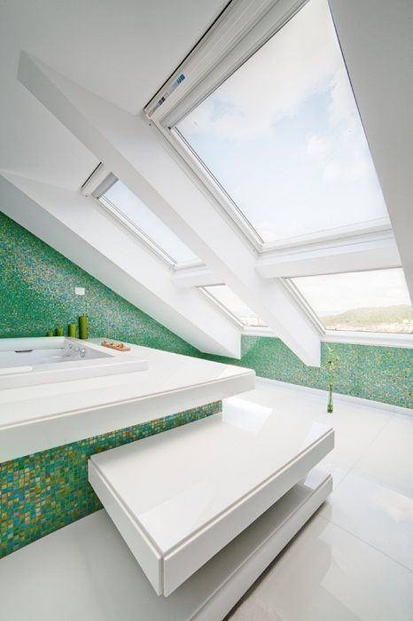 The beautiful design of a bathroom in white and green colors, which was located under the attic and look very dignified.
