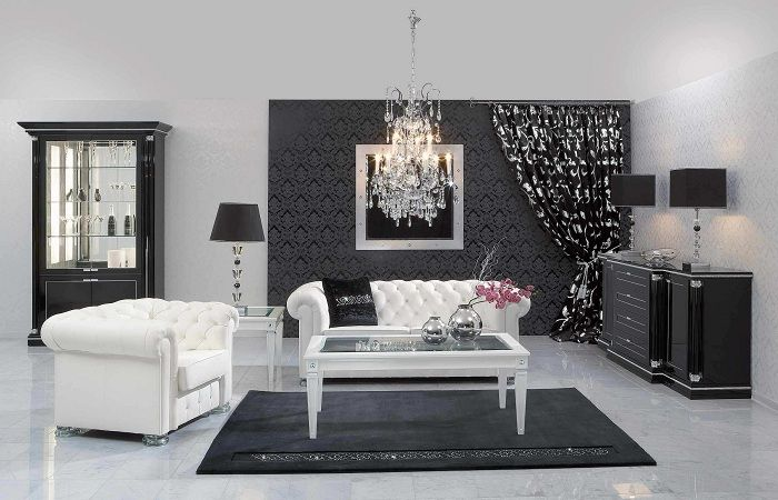 Interesting interior is created through the classical design of space in black and white colors.