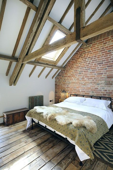 Cool interior attic bedroom in a modern style that looks amazing.