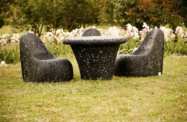 Unique chairs and a table in the garden
