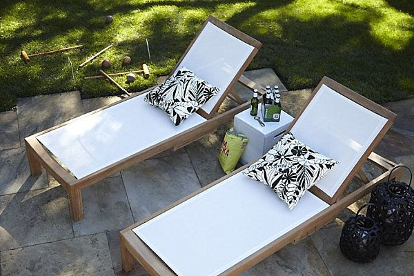 Black and white cushions on the wooden sunbeds