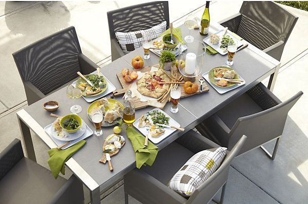 Food on a gray dining table and chairs