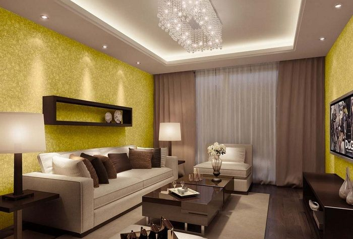 Unusual interior living room created by a wall design in golden shades and curtains in chocolate.