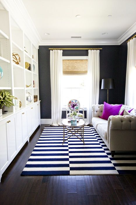 A good option to expand the space of the living room with striped black-and-white carpet.