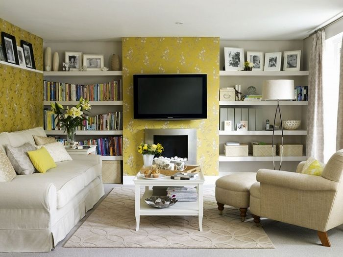 Cute tiny interior of a living room transformed by the use of yellow colors.