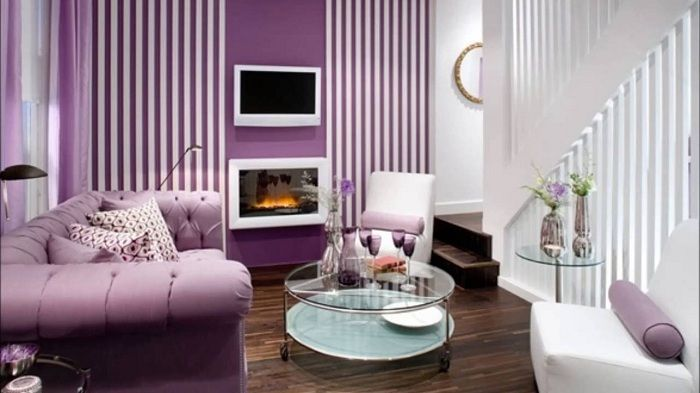 Living room with a small area is decorated in shades of purple, which adds even more elegance and tenderness.