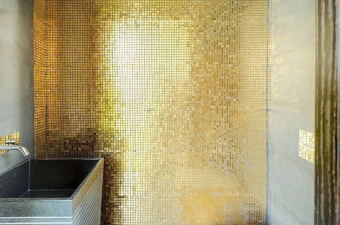 Cute small golden mosaic will be a great solution for decorating a room of this type.