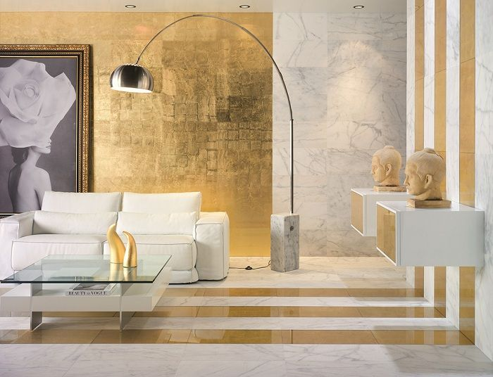 Unusual interior living room is created by combining white tones with gold.