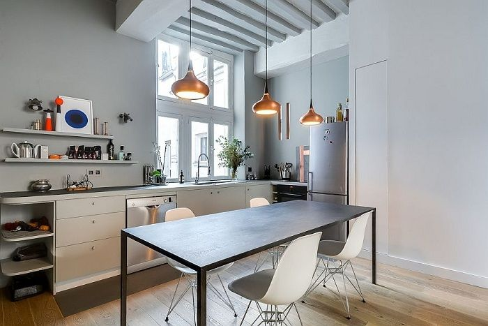 Stylish example of kitchen design in modern creative motifs with gold chandeliers.