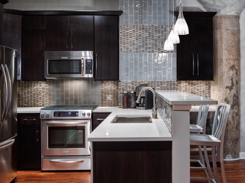Contrasting kitchen with black cupboards