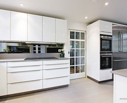 White kitchen with tiles on the floor