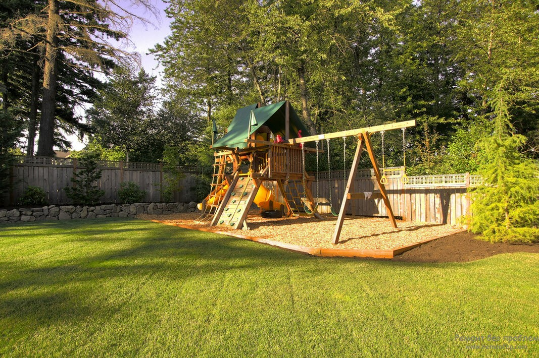 A cozy children's house complete with swings and slides